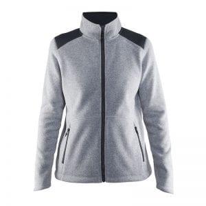 CRAFT Noble Zip Fleece, Fleecetrøje kvindemodel med lynlås foran og detaljer på skuldrene. Holder godt på varmen. Lys grå med sorte detaljer model