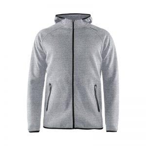 CRAFT Emotion Full Zip Hoodie, lækker kvalitets sweatshirt med hætte bagpå. Lynlås lommer og lang lynlås på maven. Flexibel og comfortable at have på. Lys grå model