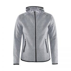 CRAFT Emotion Full Zip Hoodie kvindemodel, lækker kvalitets sweatshirt med hætte bagpå. Lynlås lommer og lang lynlås på maven. Flexibel og comfortable at have på. Lys grå model med sorte detaljer