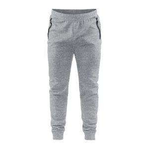 CRAFT Emotion Sweatpants, sweat bukser i lys grå udgave med sort detalje ved lynlåslommerne i siden.