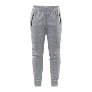 CRAFT Emotion Sweatpants Kvindemodel, sweat bukser i lys grå udgave med sort detalje ved lynlåslommerne i siden.