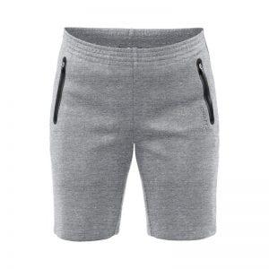 CRAFT Emotion Sweatshorts kvindemodel, sweat shorts i lys grå udgave med sort detalje ved lynlåslommerne i siden.