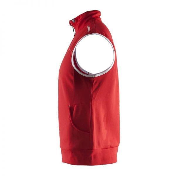 CRAFT Luisure Vest uden ærmer og med lommer og lynlåsdetalje i rød med hvide detaljer fra siden
